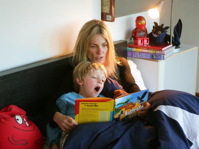 Mum Charlotte reads to son Frederick at their Roseville Chase home.