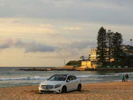 A Mercedes finds its way on to the beach at Dee Why last September.
