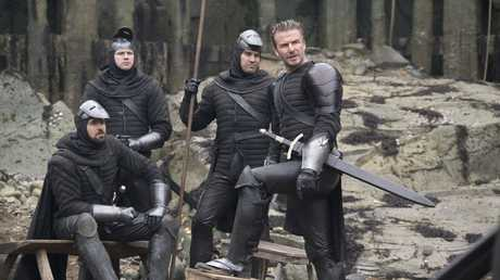 David Beckham, right, in a scene from the movie King Arthur: Legend of the Sword.