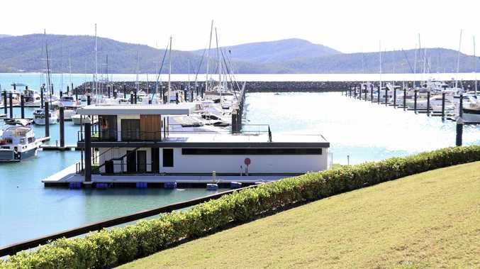 FLOATING BEAUTY: The Ocean Club is the newest edition to the southern end of Abell Point Marina and and it's a stylish touch to the already charming marina.
