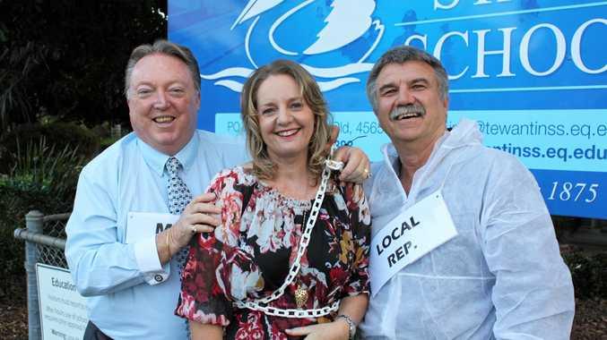 CHAINED UP: Noosa MP Glen Elmes, Chappy Lynda Oakley and Noosa Councillor Joe Jurisevic.