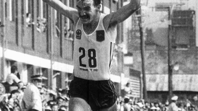 Australia's Robert De Castella races over the finishing line to clinch the gold medal in the Commonwealth Games marathon, in Brisbane, Australia, Oct. 8, 1982. He was timed at 2 hours 9.18 minutes, with Tanzania's Jumm Ikangaa second and England's Michael Gratton in third place. (AP Photo)