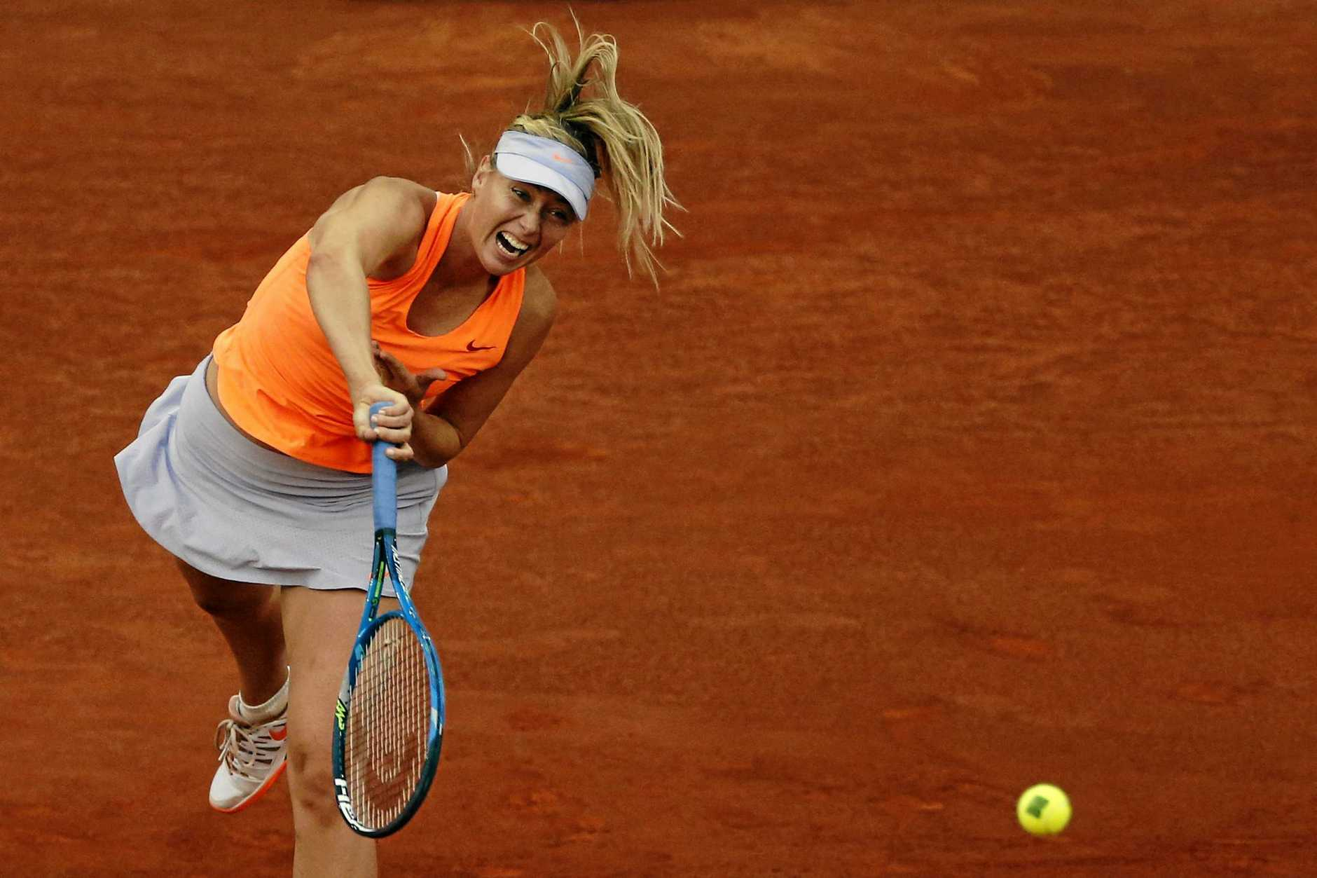 Sharapova in action during her second round match against Canada's Eugenie Bouchard at the Mutua Madrid Open