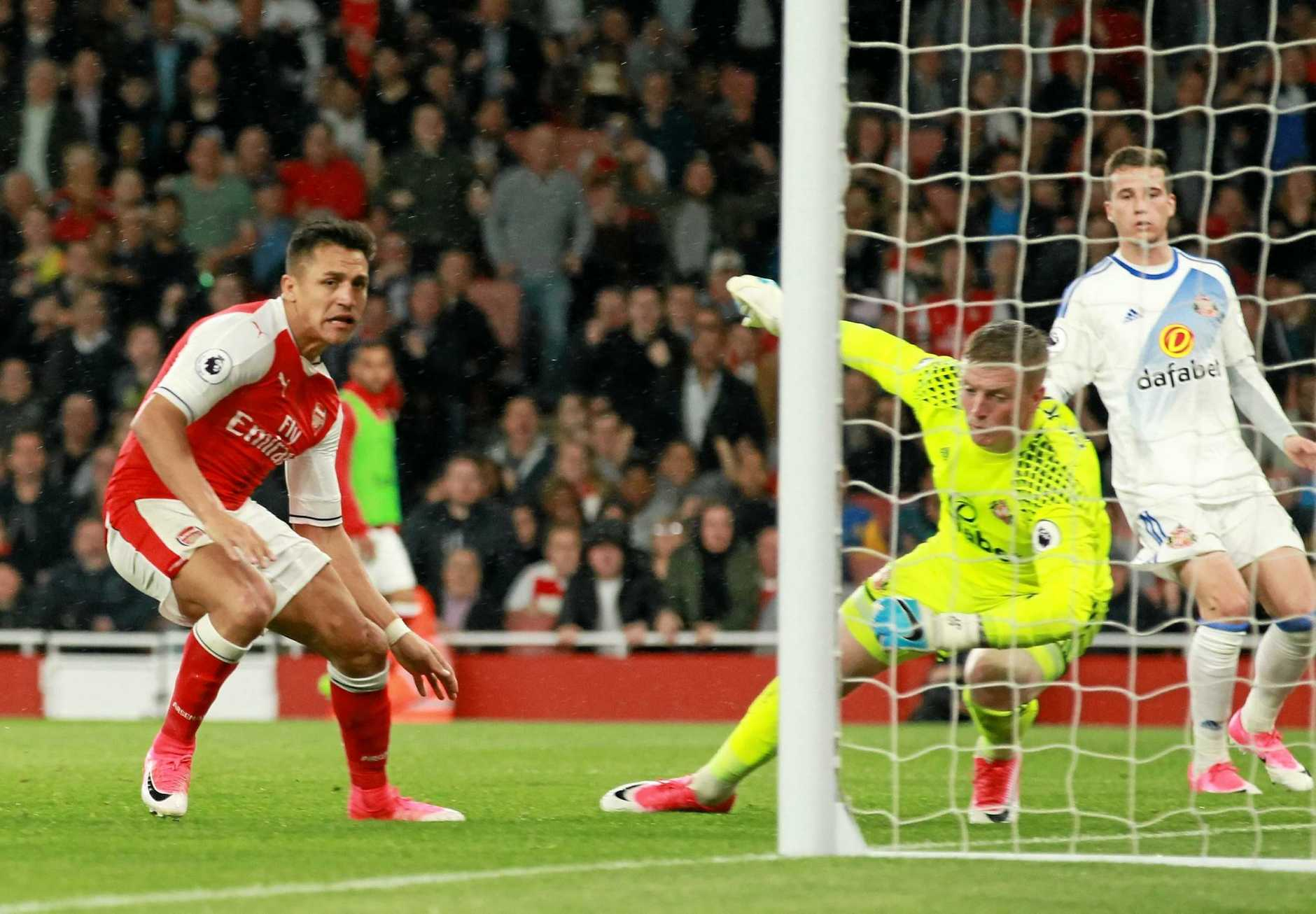 Arsenal's Alexis Sanchez (left) scores a goal against Sunderland in the 2-0 win.