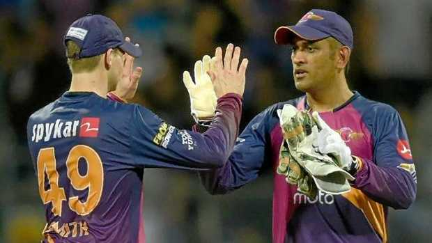 Rising Pune Supergiant captain Steven Smith celebrates with teammate Mahendra Singh Dhoni after winning the first 2017 Indian Premier League (IPL) Twenty20 Qualifier. Photo:AFP