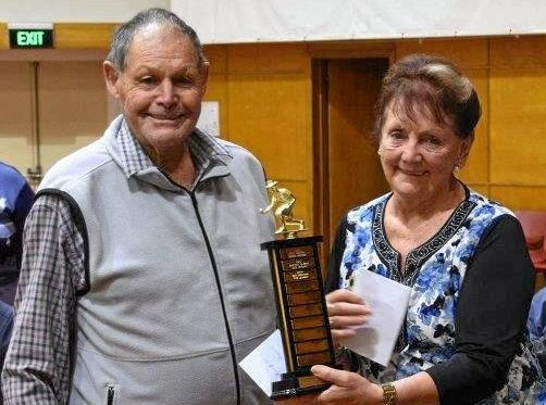 HAPPY COUPLE: Lawn bowls pairs champions Des and Val Hohn receive the Rex Brown Memorial trophy on Monday night at Pittsworth Town Hall.