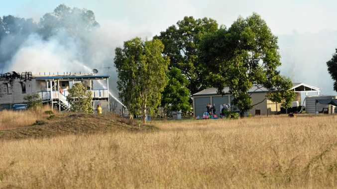 Firefighters work hard to keep a house fire under control in Summerholm on Wednesday, May 17.