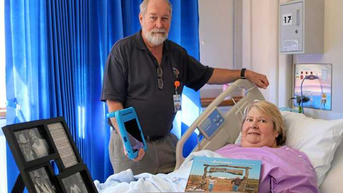 HEARTFELT GOODBYE: Pastoral carer David Johnstone with recovering Toowoomba Hospital patient Healen Jackson who was able to watch her father's funeral from her hospital bed thanks to telehealth technology.