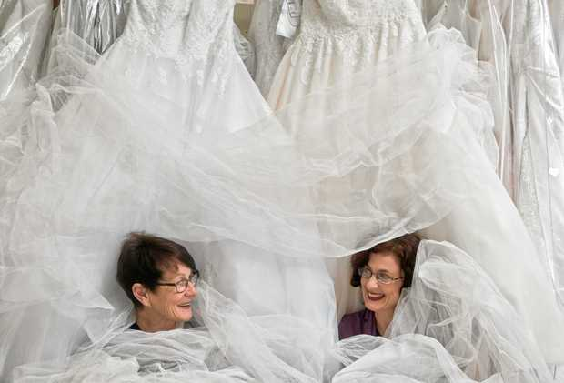 TULLE TIME: Grafton Wedding Expo organiser and wedding decorator Carol Davies and Leah Stevenson of Lasting Impressions Bridal and Formal Wear work their way through a mountain of tulle before this Sunday's Grafton Wedding Expo.