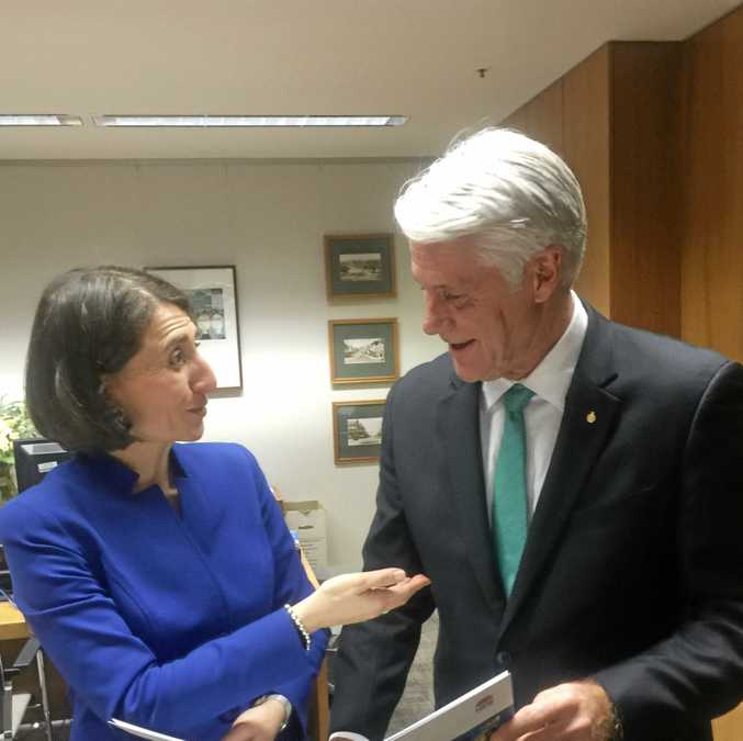 New South Wales Premier Gladys Berejiklian  and Tweed MP Geoff Provest provide financial assistance to Lifeline for flood relief.