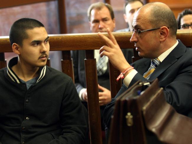 Former Sydney schoolboy John Zahariev, 21, and his lawyer in Bulgaria.