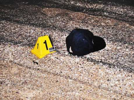 Police evidence photo of the German backpacker's hat, found at the scene.