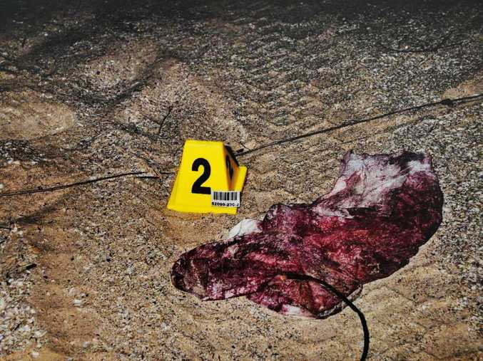 Police evidence photo showing a blood-soaked towel that one of the backpackers used after she was struck in the head repeatedly.