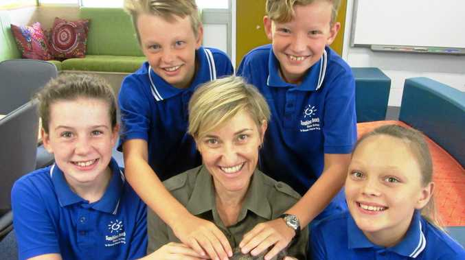 WILD LESSON:  Kirstan, from Geckoes Wildlife, introduces the pygmy crocodile to (L-R) Jorja, Oscar, Lachlan and Jazmin.