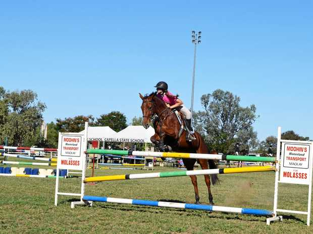 OVER THEY GO: Neve Tomkins on Quiver competing in the 3m grand showjumping event at the 2016 Capella Show.