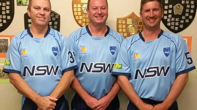 Indoor cricketers Don Grant, Dale McNellee and Tim Hamilton proudly show off the NSW colours they'll be wearing over the next week.