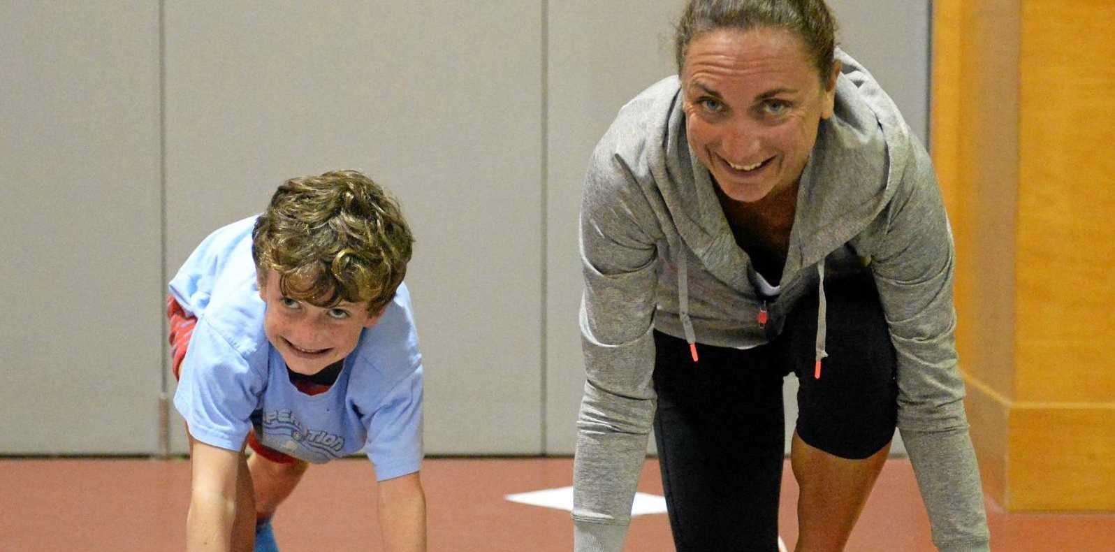 IN TRAINING: Emma Carney (right) with her son Jack, 6, who is helping at her running session, at Whitsunday Anglican School on Thursday afternoon.