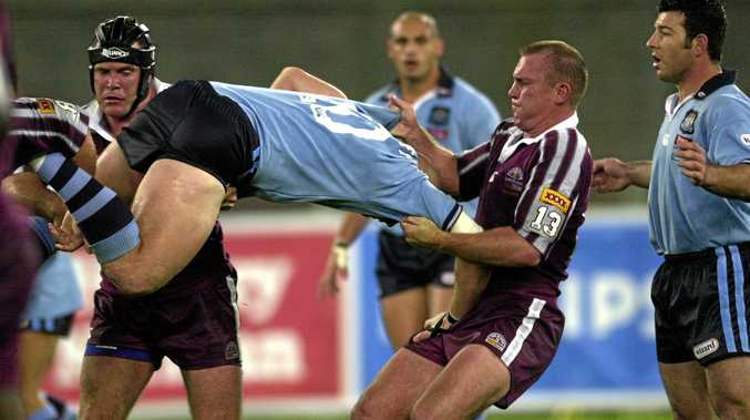 New Seagulls' assistant coach Kevin Campion lays a tackle in a State of Origin match during his playing days.