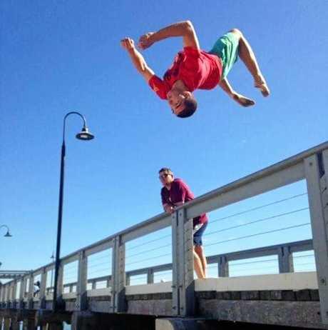 Leigh Olsen performs a back flip.