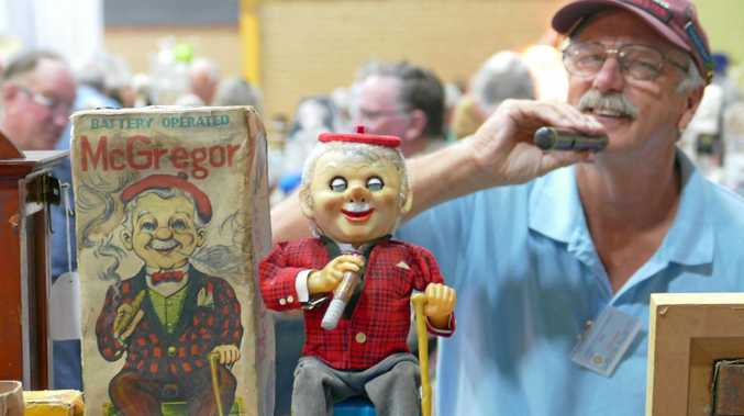 Keith Aggett from Aggett's Antiques based at Old Grevillia, with his tinplate 'Boys Toys' at Alstonville Antiques and Collectables Fair.