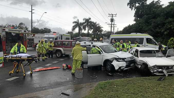 CRUSHED: One person is still trapped in a crushed car involved in a three-vehicle crash.