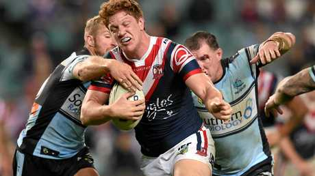 Dylan Napa (centre) of the Roosters is tackled by Paul Gallen (right) and Matt Prior of the Sharks during the round 19 NRL match between the Sydney Roosters and the Cronulla Sutherland Sharks at Allianz Stadium in Sydney on Monday, July 18, 2016. (AAP Image/Paul Miller) NO ARCHIVING, EDITORIAL USE ONLY