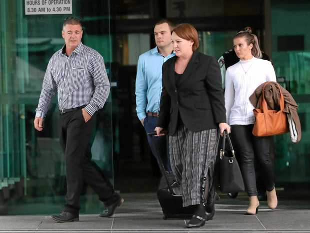 BRAVE: Michael Ackerman (left), father of James Ackerman, and Saraa Ackerman (right, white top) leave the pre-inquest conference into his death .