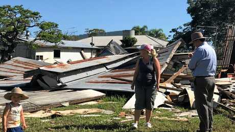 DEVASTATING: Bororen primary producer Stacey McNab shows member for Burnett Stephen Bennett what's left of her hay shed, which took a battering from Ex-Tropical Cyclone Debbie.