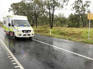 An ambulance leaves the scene at the Peak Downs Highway.