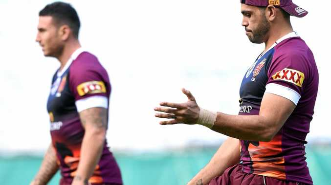 OFF-FIELD BATTLES: Queensland Maroons teammates Darius Boyd (left) and Greg Inglis.