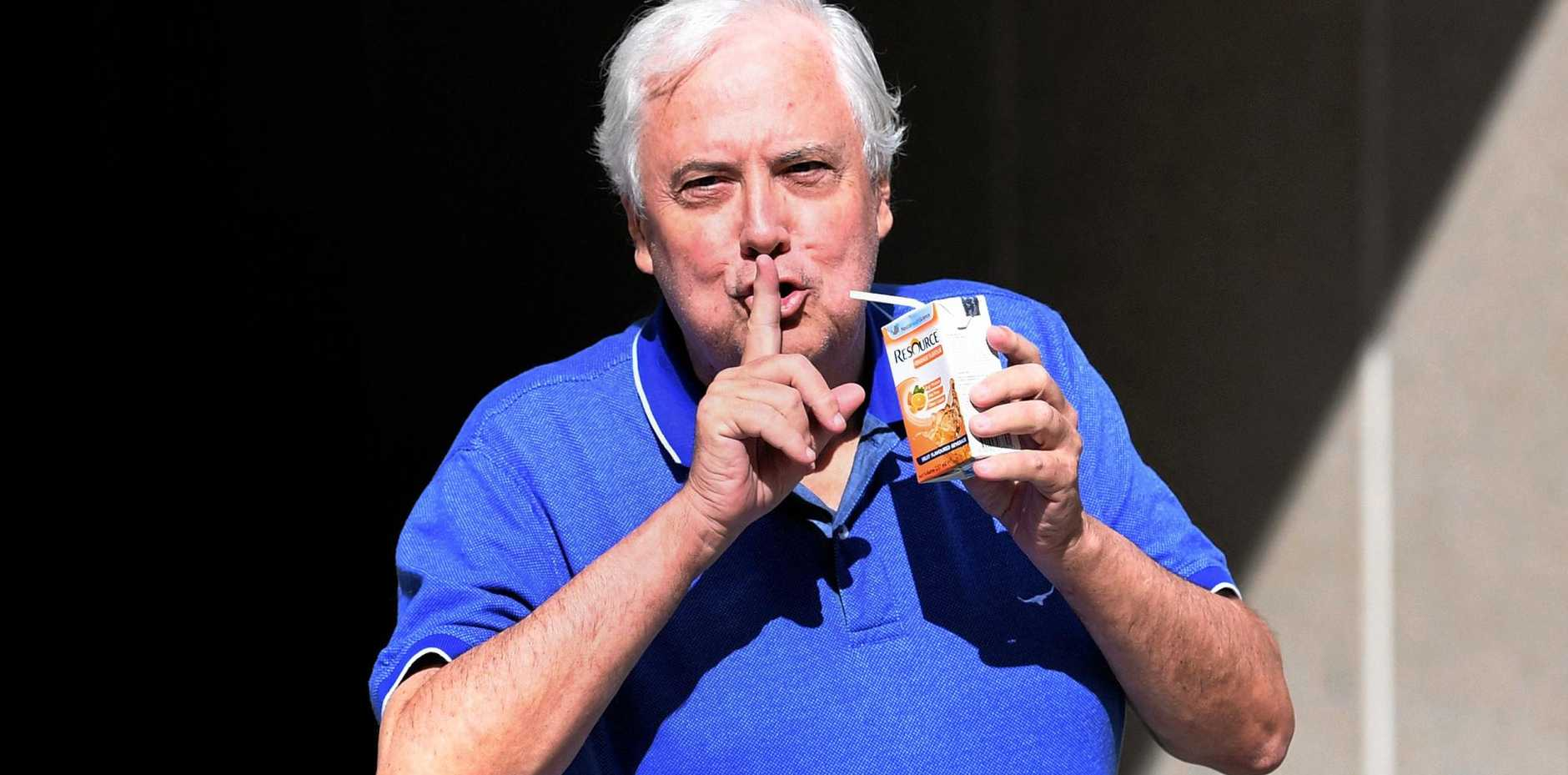 Businessman and former federal MP Clive Palmer gestures to the waiting media as he leaves the Federal Court in Brisbane, Wednesday, May 17.