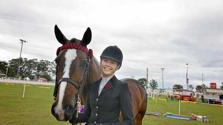 VICTORY: Cooran's Ali Berwick and her mount, Freemantle, a warmblood gelding, were among the last Gympie Show winners to hear their names called by veteran Show announcer Alain Henderson, who retires on Saturday. She won the Supreme Led Horse section of the Gympie Show ring events for 2017.
