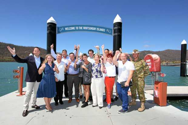 Federal Tourism Minister Steven Ciobo, State Tourism Minister Kate Jones, Tourism Whitsundays chairman Al Grundy, Whitsunday Mayor Andrew Willcox, Tourism Whitsundays CEO Craig Turner, Cruise Whitsundays CEO Nick Hortle, BIG4 Adventure Whitsunday co-owner Naomi McKinnon, Federal Member for Dawson George Christensen, Carnival Australia executive chairwoman Ann Sherry AO, Ocean Rafting co-owner Peter Claxton, Charter Yachts Australia co-owner Annie Judd, Whitsunday Transit manager Ben Malady, Mantra Club Croc GM Luke Harley and Brigadeer Chris Field celebrating the fact that the Whitsundays is open for business.