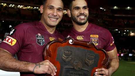 Justin Hodges and Greg Inglis in happier times. Pictures: Adam Head