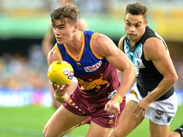 Ben Keays of the Brisbane Lions gets a handball away against the Port Adelaide Power.
