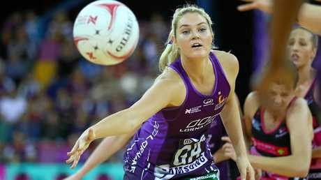 Gretel Tippett passes during the round 12 Super Netball match between the Firebirds and the Thunderbirds at the Brisbane Entertainment Centre