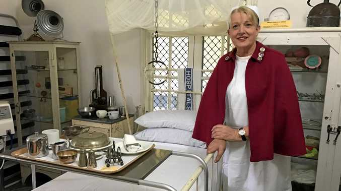 A PIECE OF HISTORY: Nursing director Trish Spreadborough shows what it would have been like to care for patients in the early days of the Maryborough Hospital.