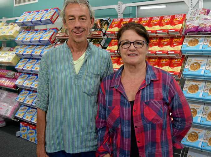 BIG JOB: Anglicare volunteers James Walker and Pam Smith preparing the new Anglicare Low Cost Food Bank store, due to open at 14 Wood St by the end of the month.