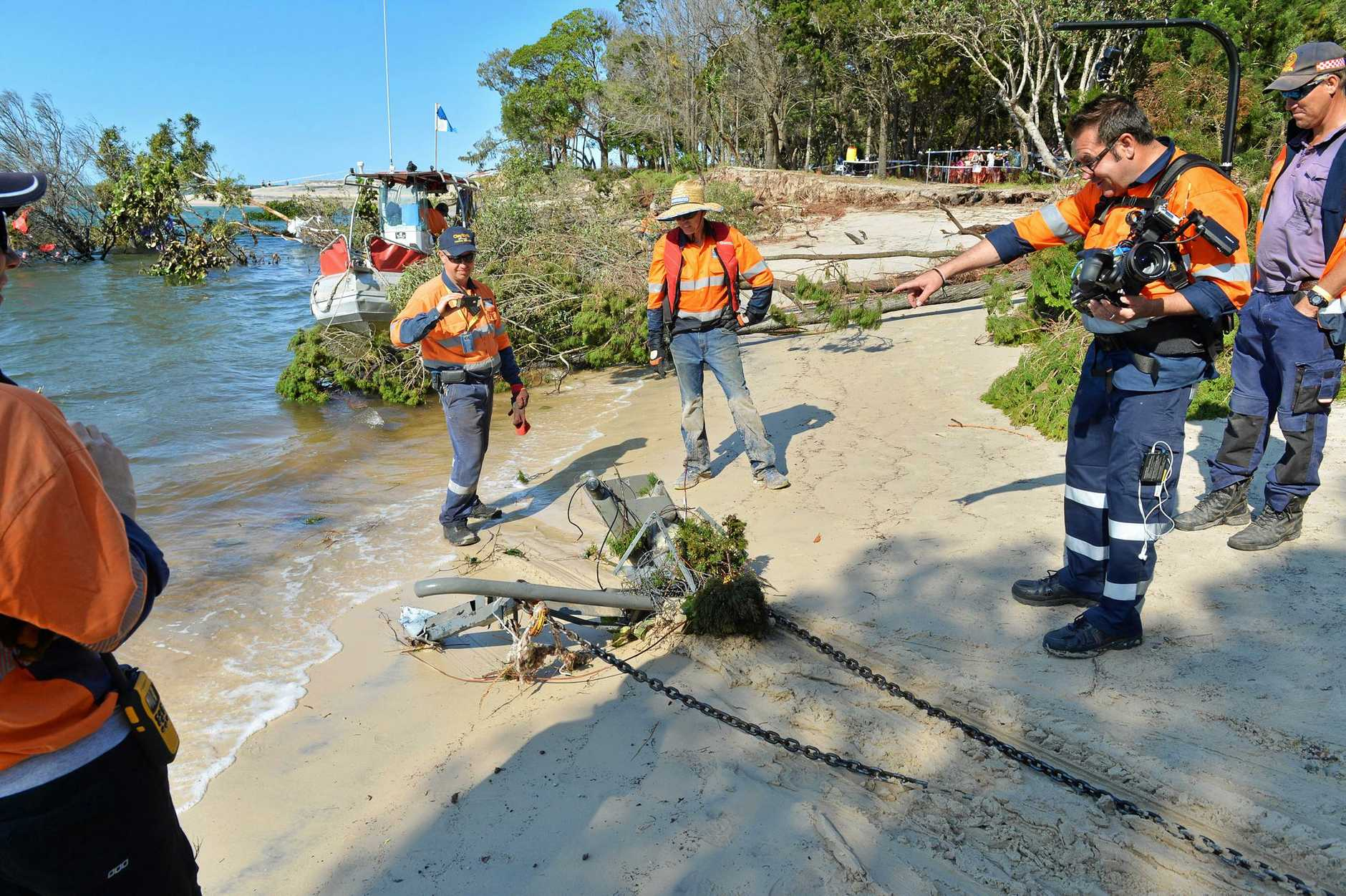 Inskip Point near Rainbow Beach. Recovery attempt for the caravan and 4 wheel drive that were swallowed up by the sinkhole/underwater landslide. Claytons Towing attempted the salvage operation. Claytons workers make up a block and tackle to get more leverage off the tow line.