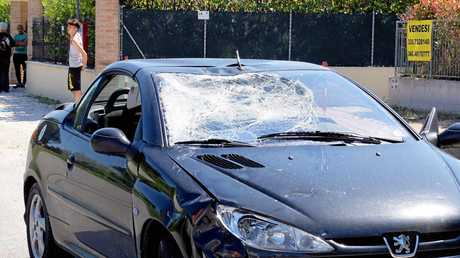 The smashed window of the car that hit Nicky Hayden.