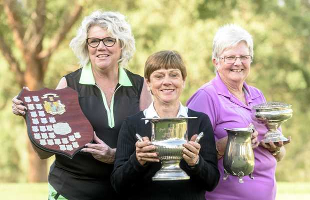 SHINING SILVERWARE: Grafton Ladies Golf Club vice-president Julie White, captain Peg James and president Heather Robinson show off some of the trophies on offer at next week's Grafton Ladies May Tournament.