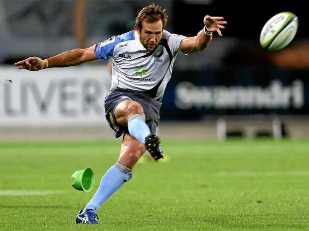 Peter Grant of the Western Force takes a kick.