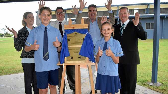 Roy Blain and Millie Cran (front) St Cath's Primary principal Sharyn Bell, Dawson MP George Christensen, Jason Costigan and secondary principal David Burke.