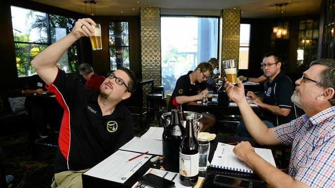 TESTED: Kieran Murphy (left) of Ipswich Brewers Union and Martin Potter taste a Belgian Saison as judges of home brews.