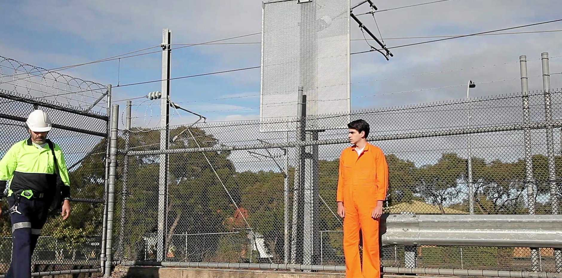 Andrew Groundwater stands on set at Zillmere Rd during An Afterlife filming.