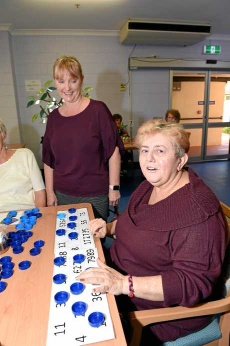 Greenhills Lodge aged care manager Jacquie Everson with Lesley Perkins, who is enjoying a spot of bingo.