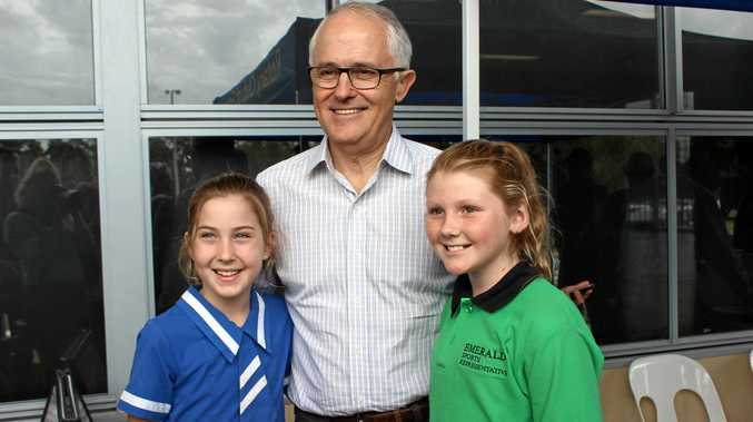 Prime Minister Malcolm Turnbull with Poppy Millar and Mave Burnett on Friday.