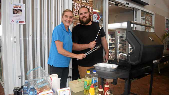 TASTY FEAST: Taryn Bodley and Joshua Hogan from Whitsunday Neighbourhood Centre cooking up snags for a great cause.
