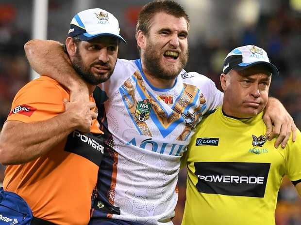 Titans player Ryan Simpkins is taken from the field.