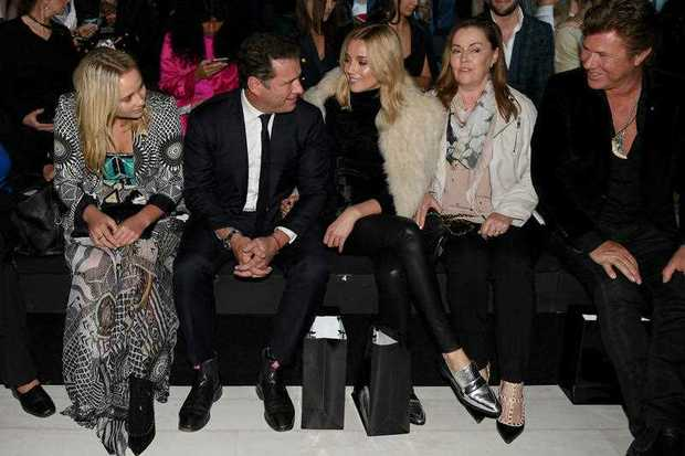 Television presenter Karl Stefanovic and Jasmine Yarbrough sit front row ahead of the Justin Cassin show during Mercedes-Benz Fashion Week Australia in Sydney, Monday, May 15, 2017.